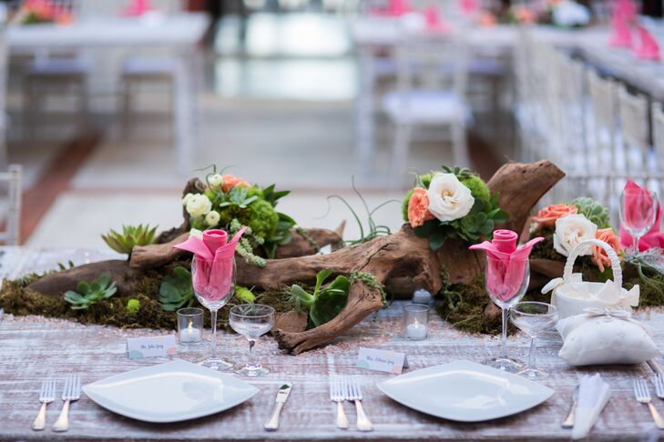 Driftwood centerpiece with roses moss succulents for Driftwood table centerpieces
