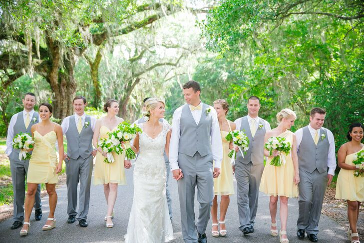Bridesmaids donned short pale yellow dresses in different styles and carried smaller versions of Carly's bouquet. Groomsmen sported gray suits with soft yellow ties.