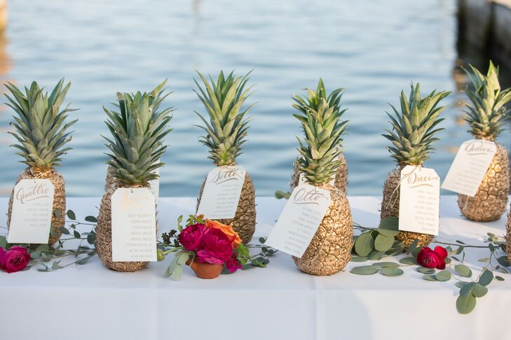 Talk about unexpected! Their seating chart was made with gold-painted pineapples. Each one had a handwritten card from PaperTangent with the table numbers written in Italian to acknowledge the couple's heritages.