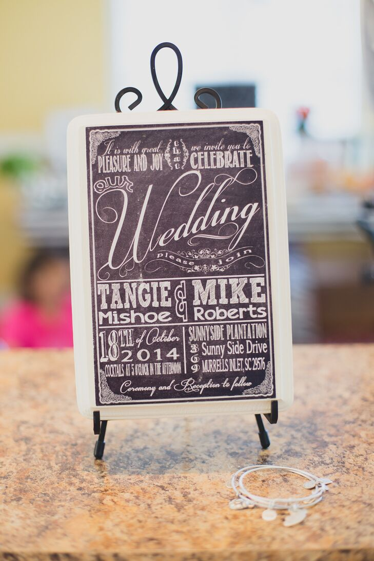 To set the tone for their country wedding, Tangie and Mike made these black-and-white chalkboard-inspired invitations for their guests. With different typefaces and ornate detailing in the corners, they were quintessential shabby chic.