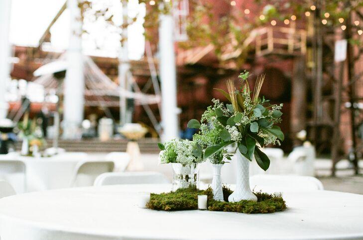 Moss and eucaplyptus table centerpiece floral arrangements