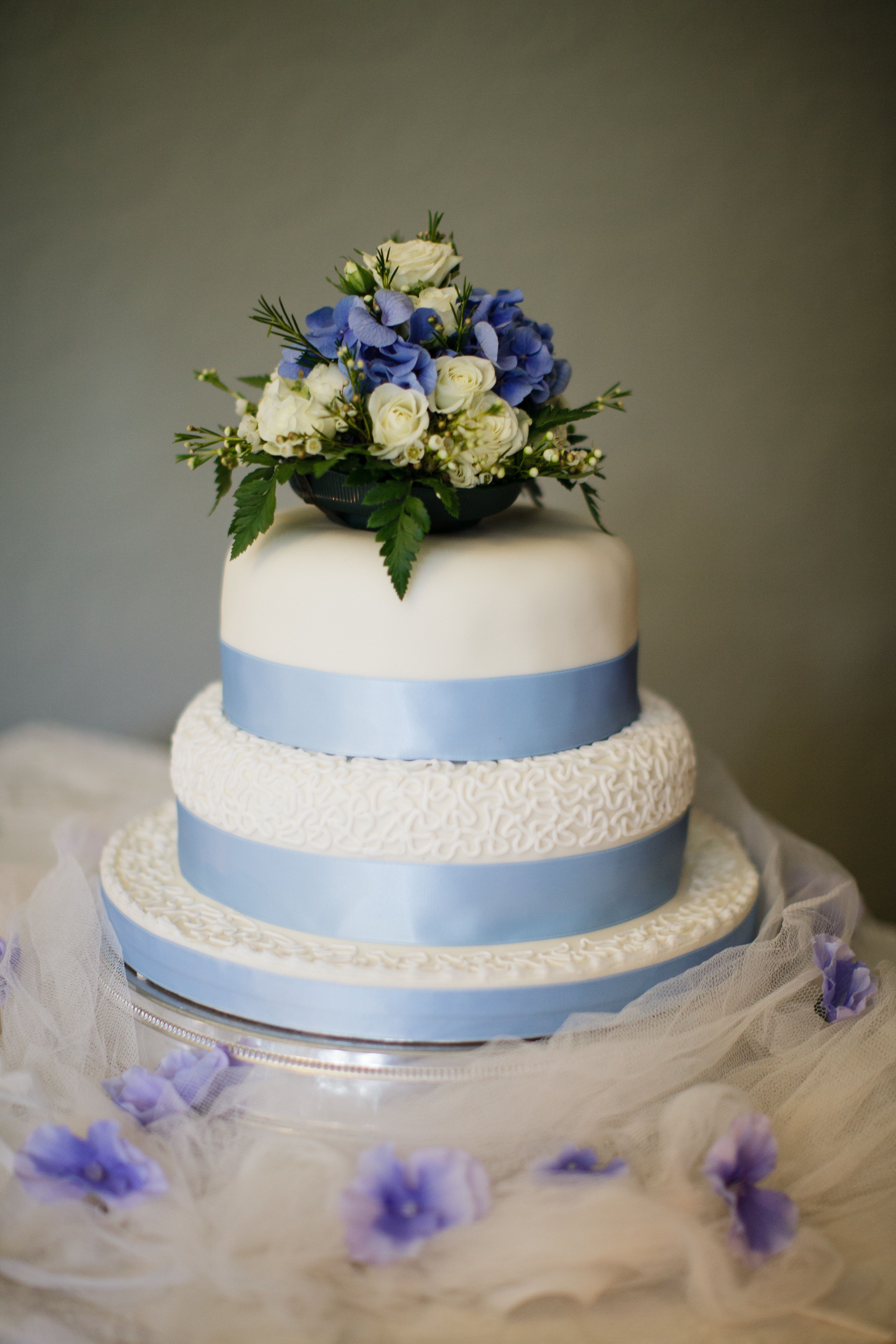 Three Tier Wedding Cake With Blue Ribbon