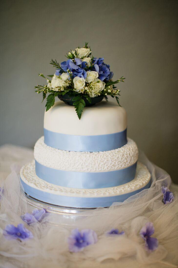 Three Tier Wedding Cake With Blue Ribbon