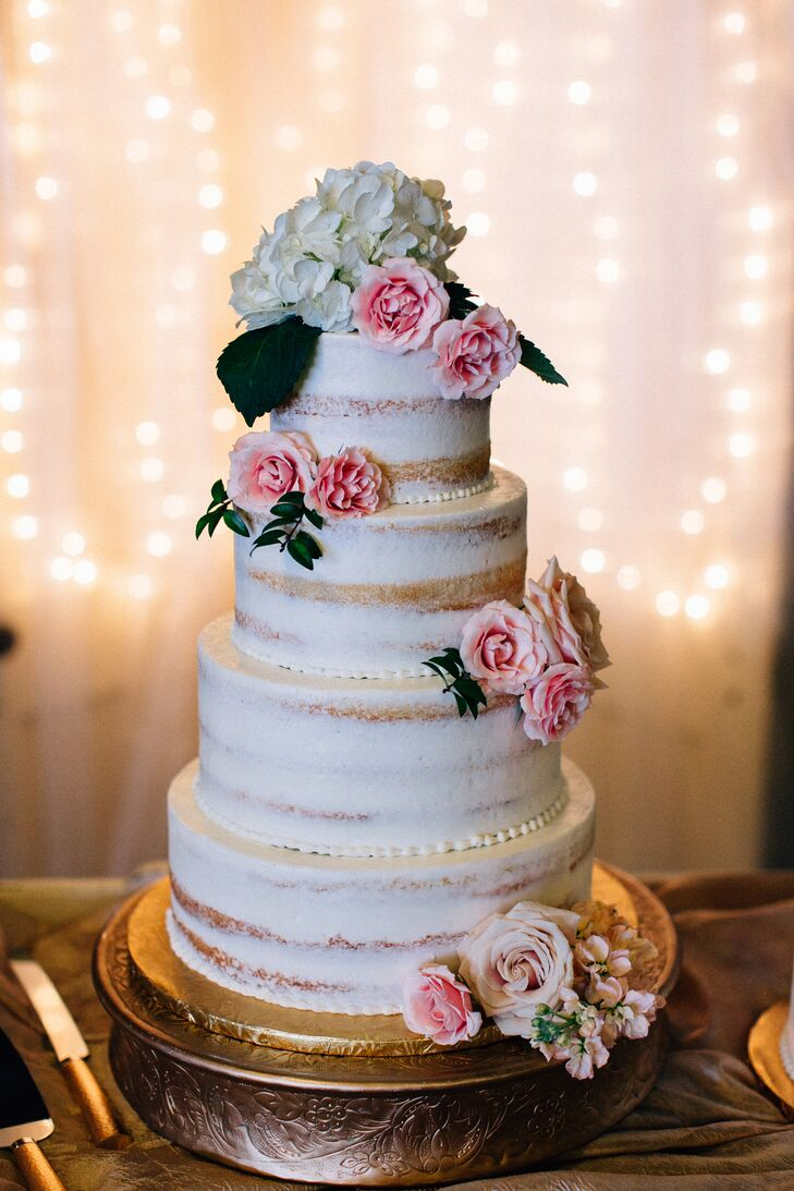 The couple served a four-tier almond-flavored naked cake, two-tier chocolate cake, and two-tier almond cake from McLain's (the same bakery that made Ashley's parents' wedding cake 30 years ago).