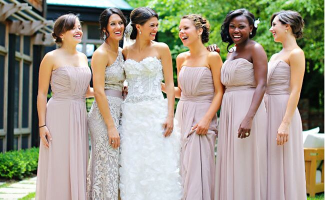 bride with bridesmaids in long blush dresses