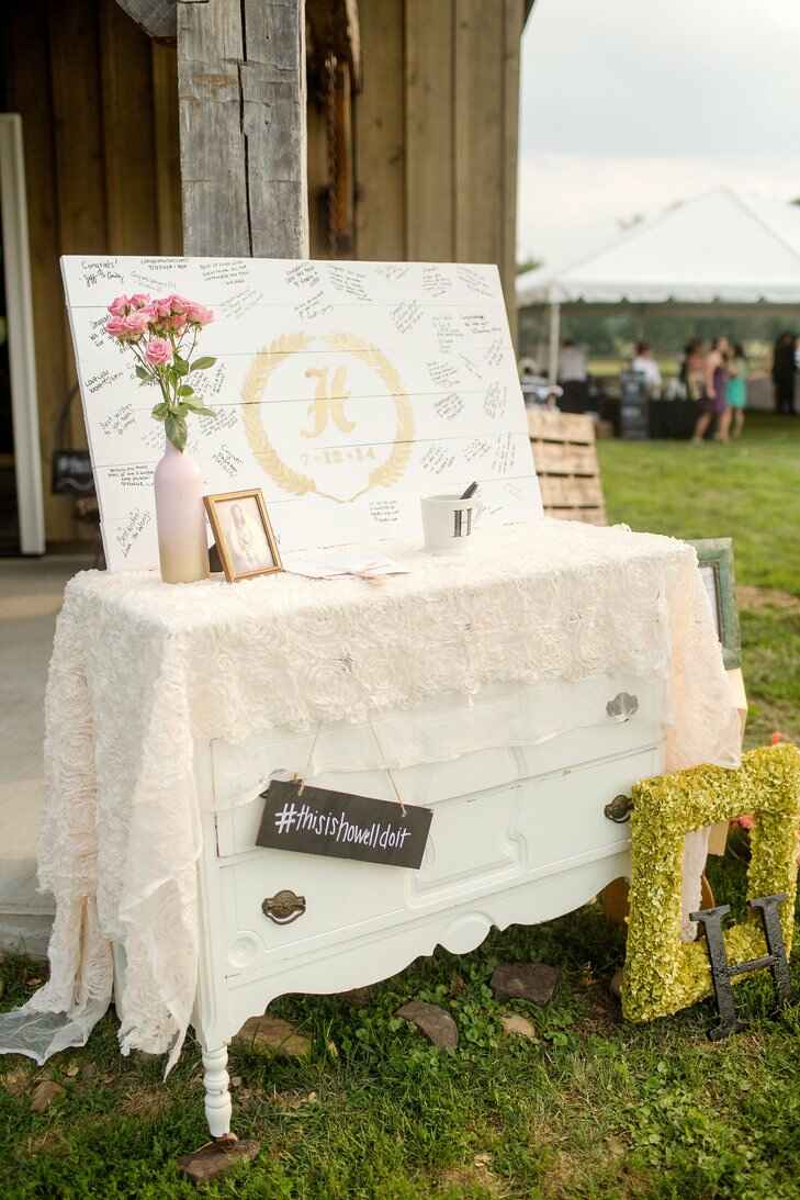 Guest book station with hanging hashtag sign