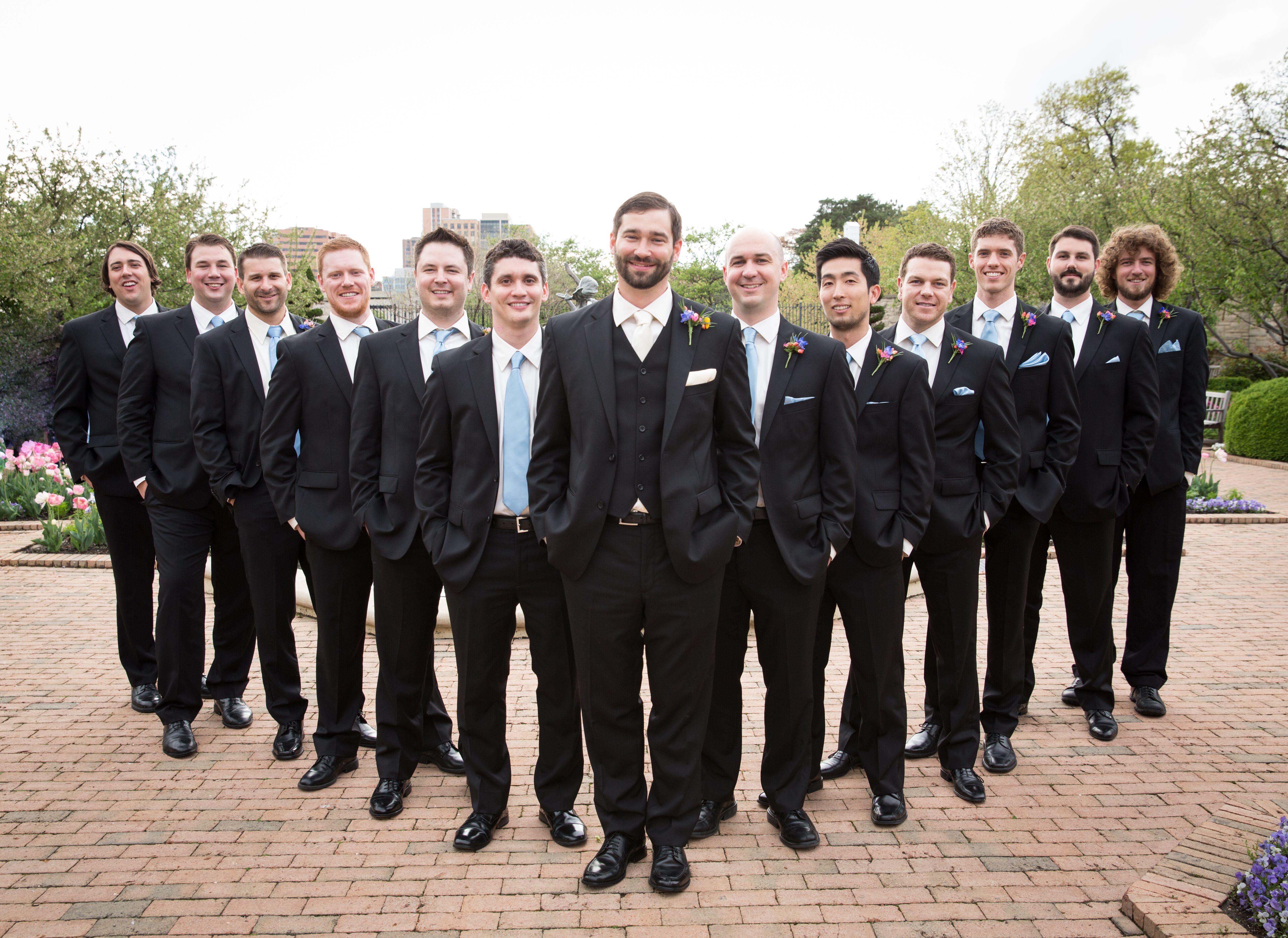 Groomsmen In Black Suits And Light Blue Ties