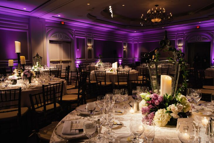 The ballroom at the Ritz-Carlton was illuminated by purple uplighting for the reception.