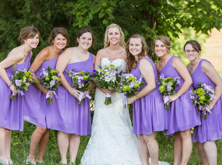 Jaime wanted a soft look for the wedding party, so she opted to outfit her bridesmaids in short lavender dresses.