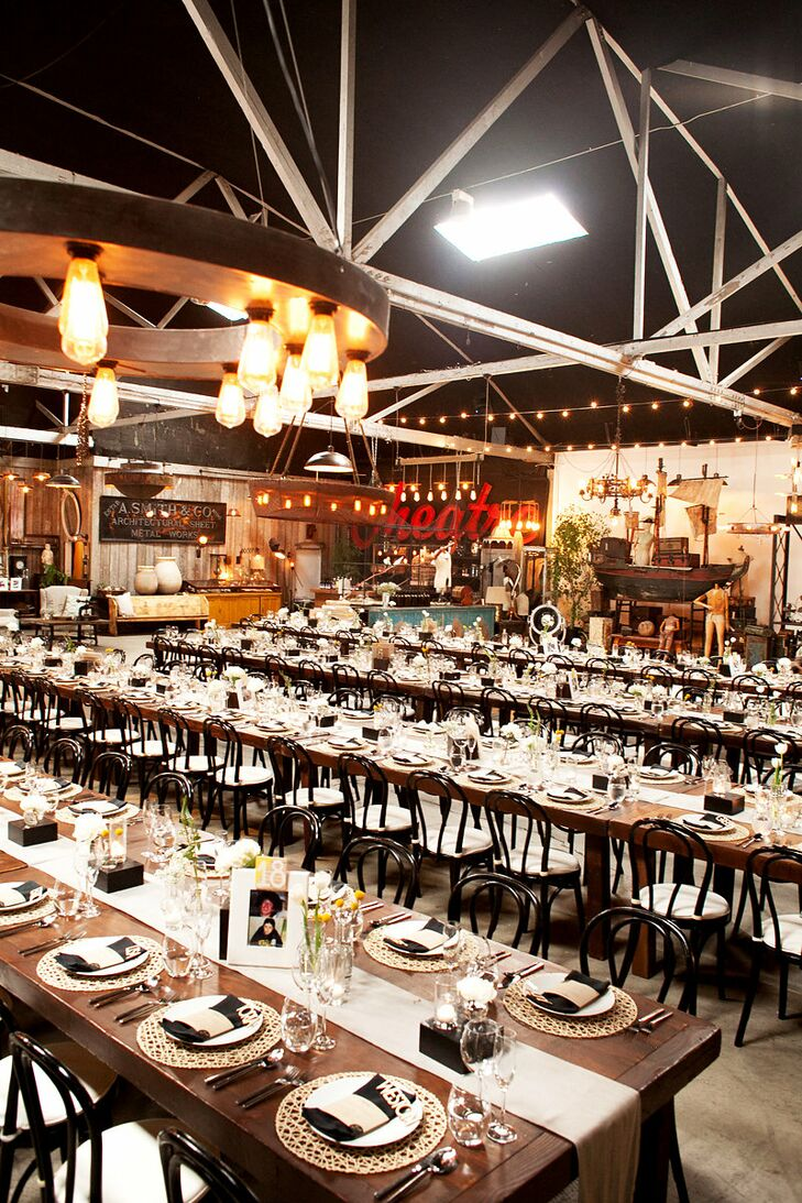 With its eclectic decor and subtle industrial feel, Big Daddy's Antiques in Los Angeles offered the ultimate backdrop for Danielle and David's ultra-personalized affair. Details like wooden farm tables, simple white linens and bud vases filled with sunny yellow crapedias played into the venue's rustic vibe, while peonies displayed atop black pedestals and laser cut accents brought a note of modernity to the decor.