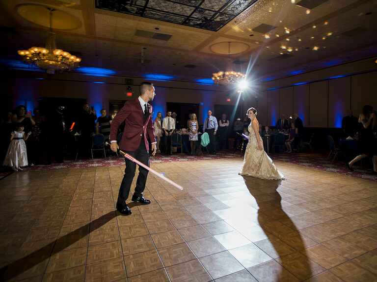 Newlywed lightsaber battle