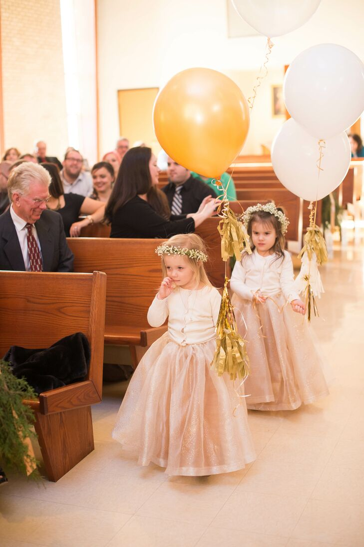 Flower Girls Carrying Oversize White And Gold Balloons