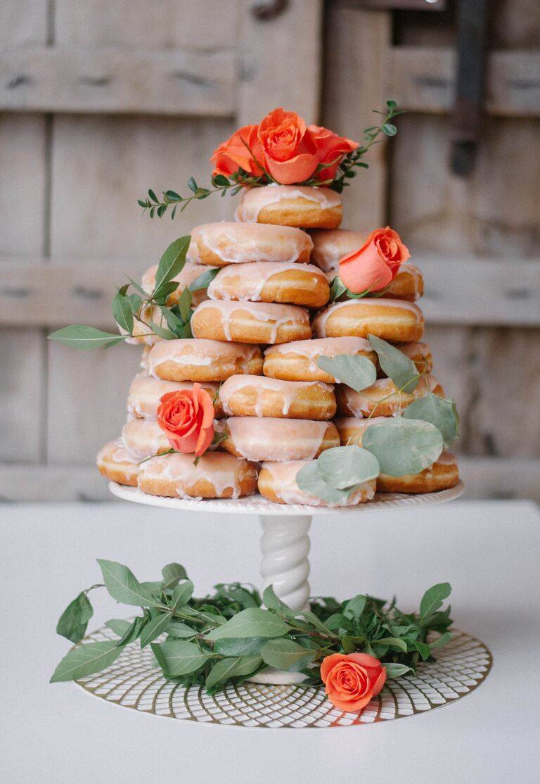 Romantic doughnuts cake with orange garden roses