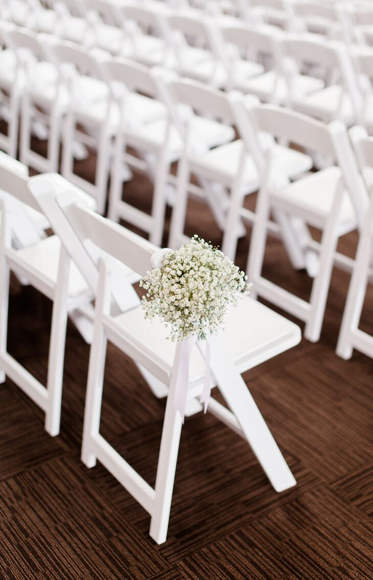 At the ceremony, white folding chairs organized into rows had bushels of baby's breath lining the aisle. These arrangements matched the other baby's breath-based bouquets and centerpieces that decorated the day.