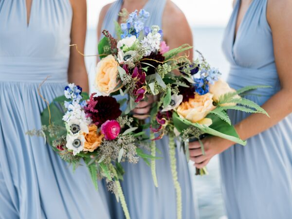 Blue wedding bouquets pale blue bridesmaid dresses and tropical bouquets mightylinksfo
