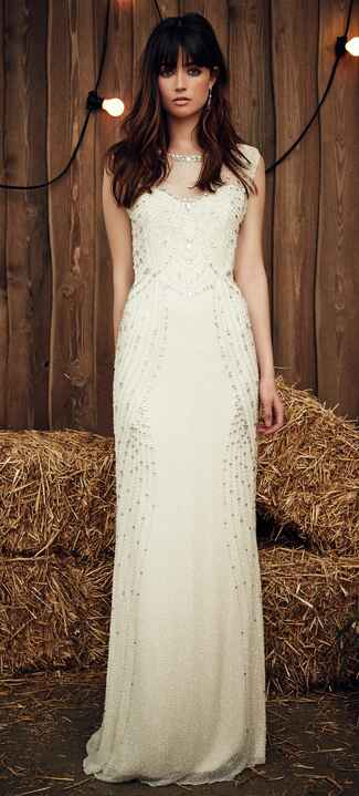 Jenny Packham Spring 2017 Betsy wedding dress in off-white with illusion neckline and crystal and pearl embellishment on an overlay along the bodice and skirt