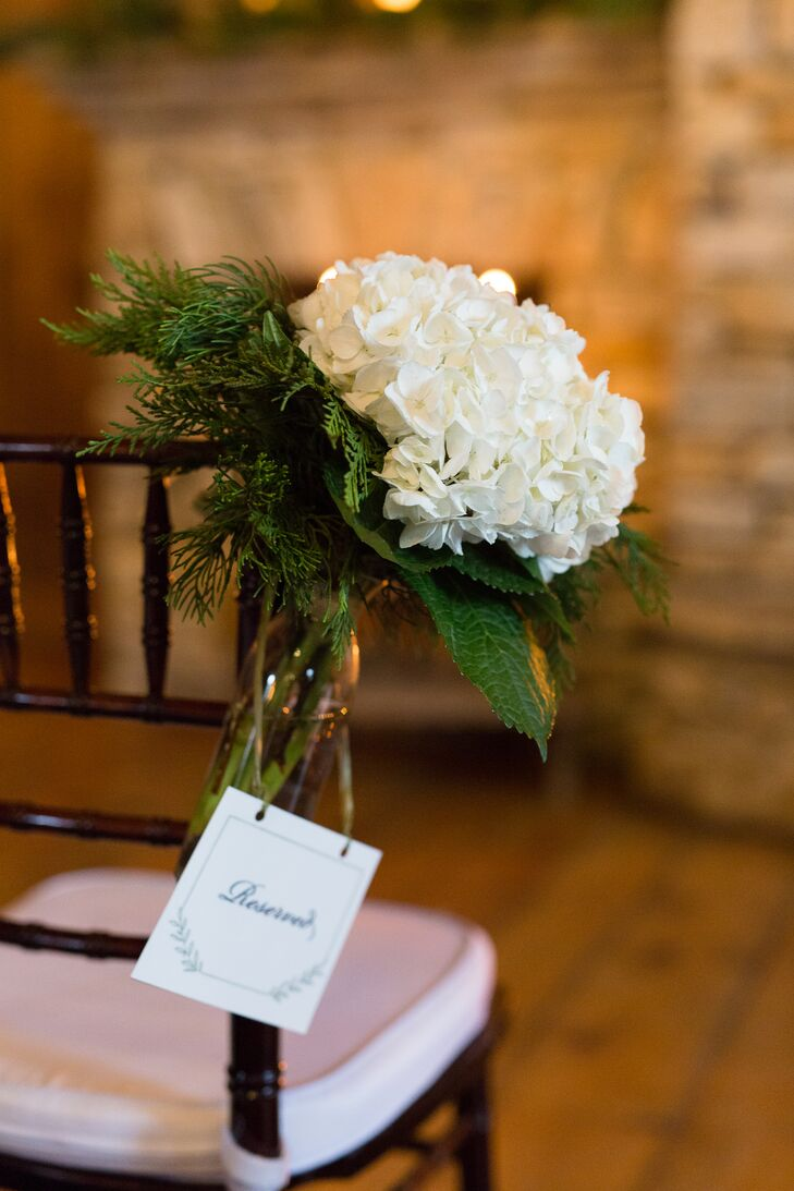 The ceremony aisle was lined with white hydrangeas and green pine hanging from the chiavari chairs. Emily and Edward loved how the gorgeous flowers went with their natural palette, but still added plenty of romance to the rustic space at Old Edwards Inn and Spa in Highlands, North Carolina.