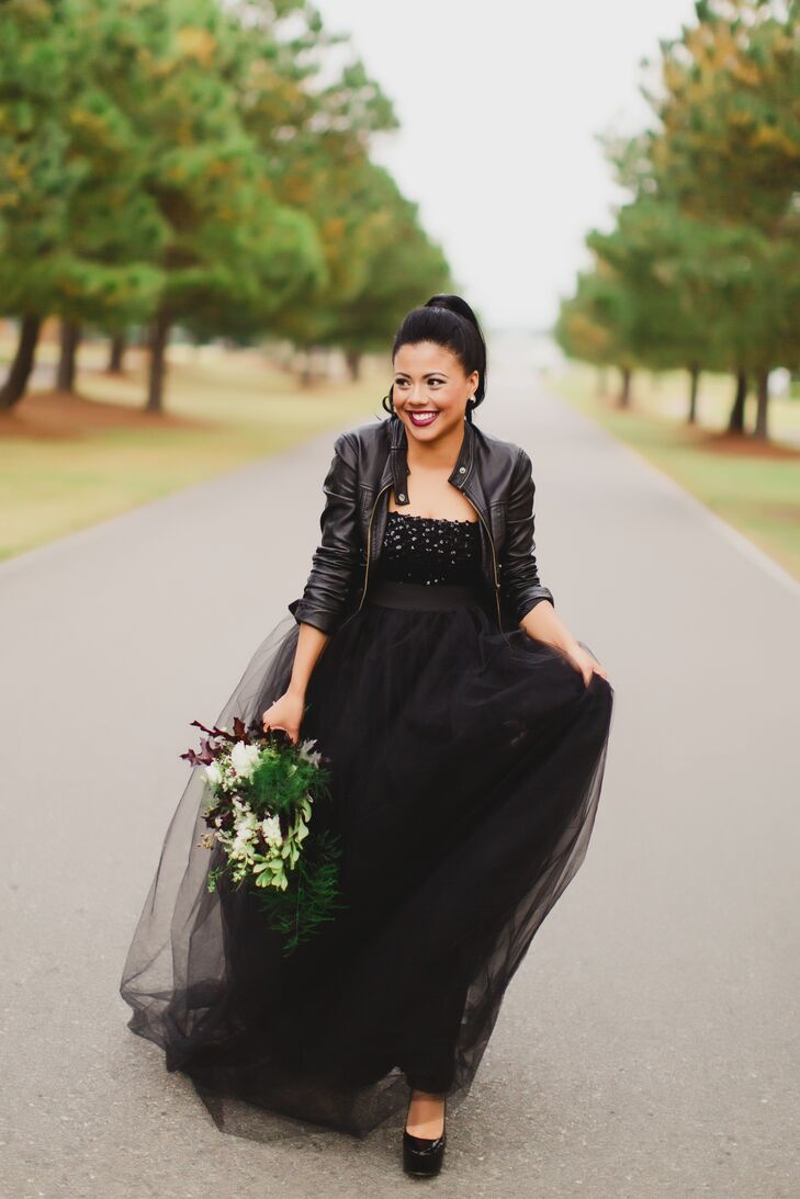 "Since Candice owns a bridal shop, she knew she wanted an avant-garde and glam dress, so she paired a black sequin top with a custom black tulle skirt. ""I have always been obsessed with the color combo of black and white,"" she says. ""I thought it'd be cool to pair it with a leather jacket. An all-black outfit is always really chic."""