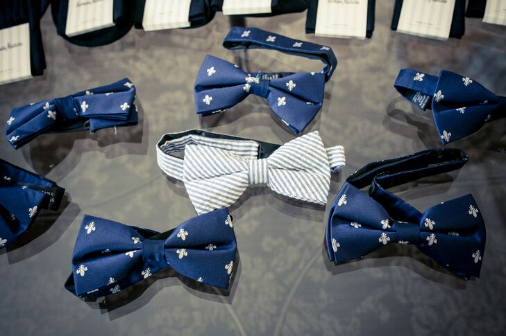 The men's looks were entirely different, right down to the ties. The groomsmen wore seersucker suits, while Adam stood out in a more classic navy. To tie them together, Adam wore a seersucker bow tie and they honored New Orleans with fleur-de-lis-accented bow ties.