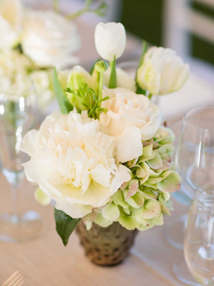 Small arrangements of white peonies, tulips and green hydrangeas decorated the long main reception table.