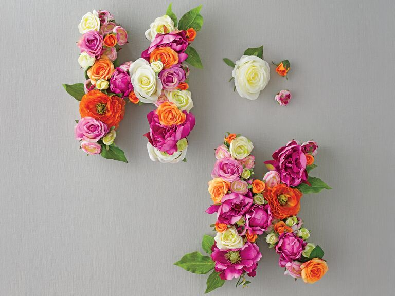 Initial monograms with silk flowers and cardboard letters