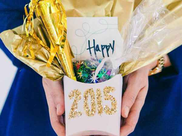 Diy a festive party packet for your New Year's Eve guests for a fun-filled way to celebrate.