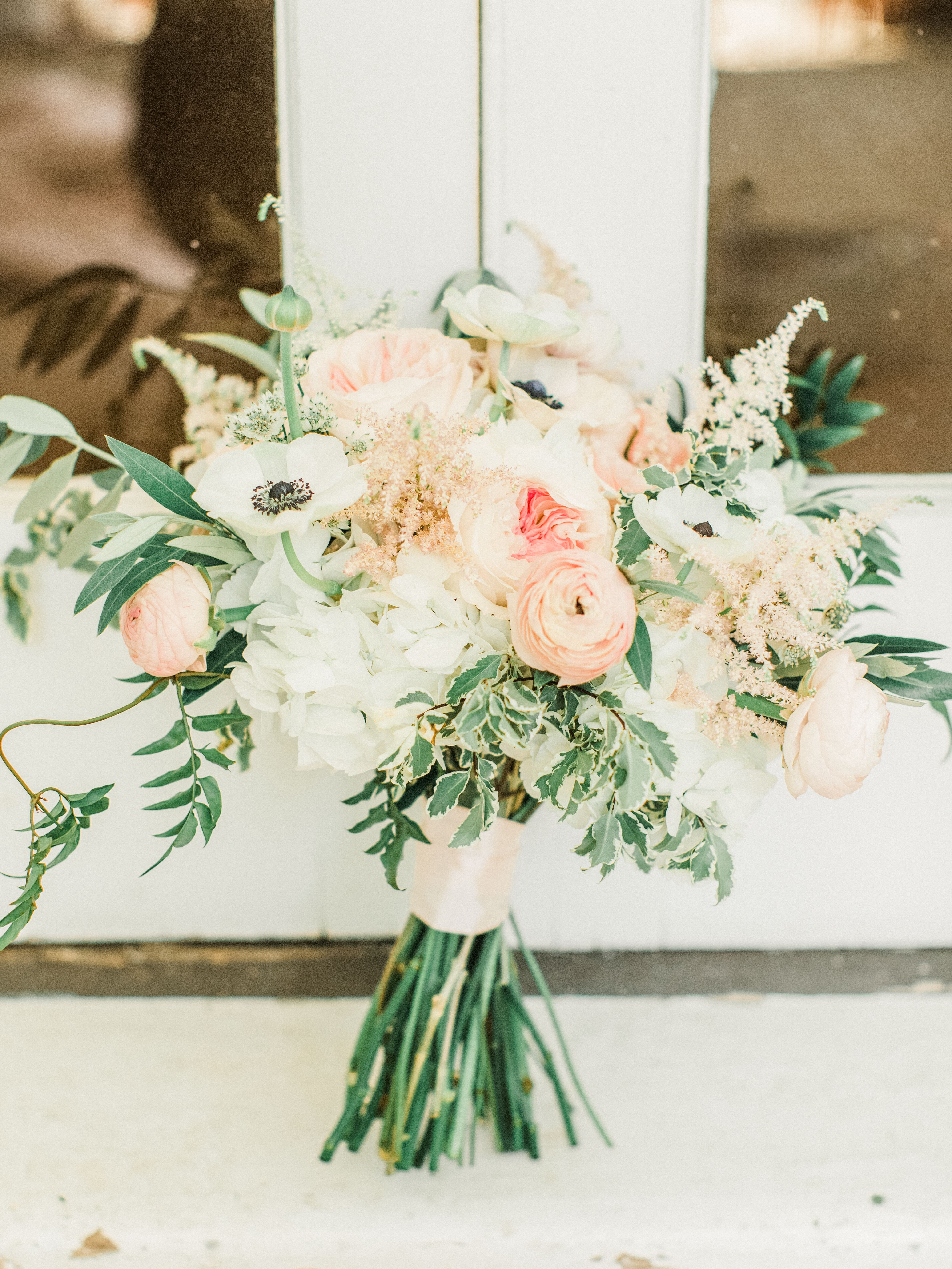 Romantic Bouquet With Pink Ranunculus Peonies Anemones And Greenery