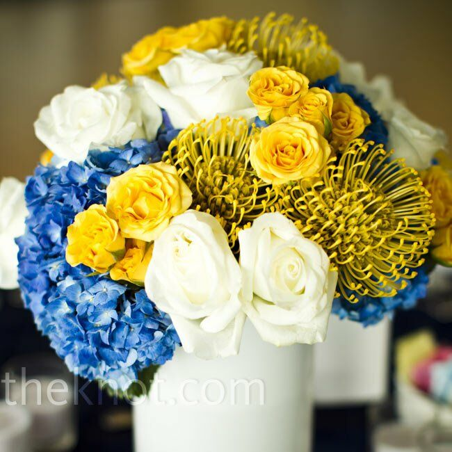 Blue yellow and white centerpieces