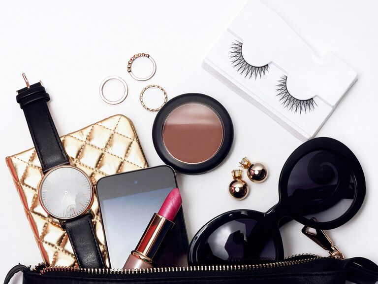 Makeup and accessories on white background.