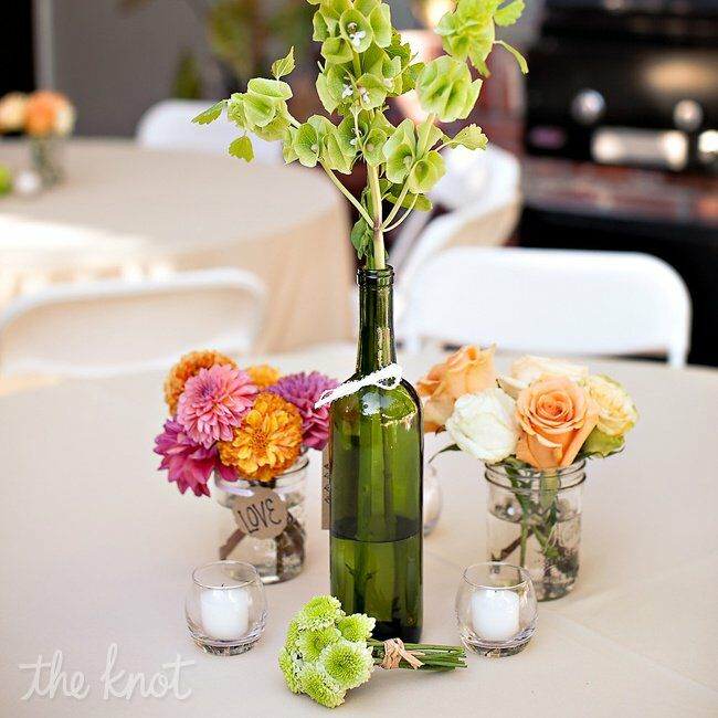 Upcycled wine bottle diy centerpieces Wine bottle wedding centerpieces