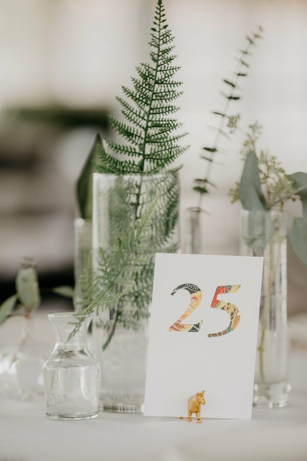Colorful Collage Table Numbers and Gold Animal Holders