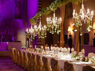 Intimate wedding reception with floral chandeliers