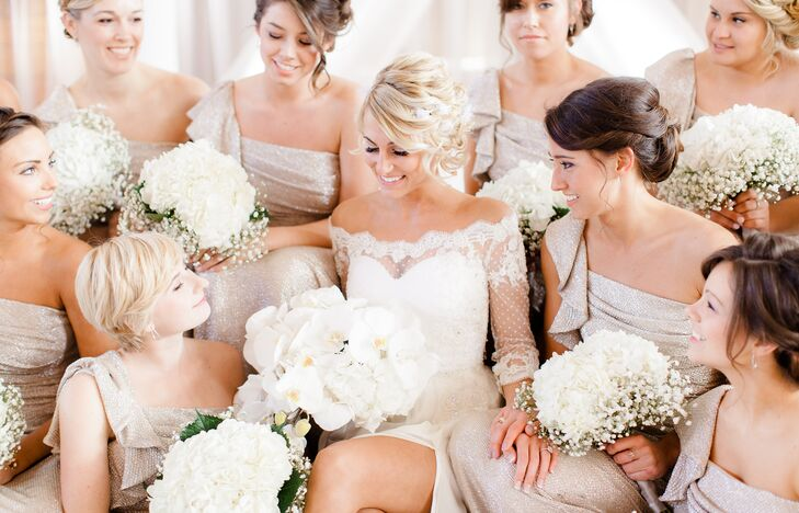 The bridesmaids dressed in champagne-colored dresses and surrounded Jenna in her white dress, all of them holding their lush bouquets filled with white hydrangeas and baby's breath.