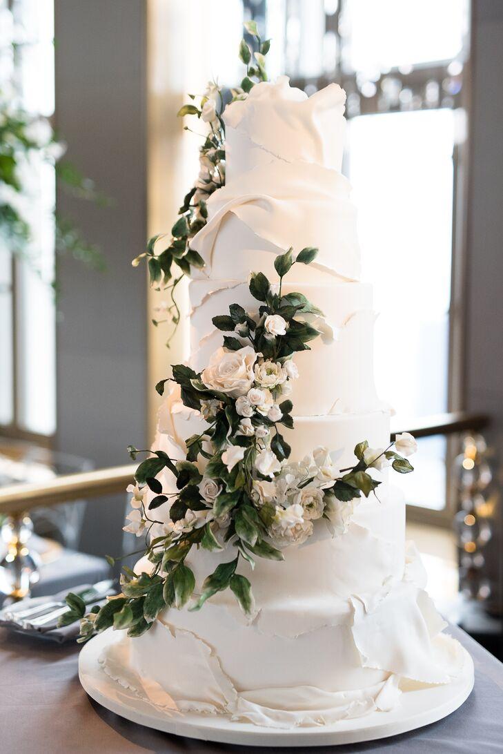 White fondant wedding cake with sugar flowers mightylinksfo