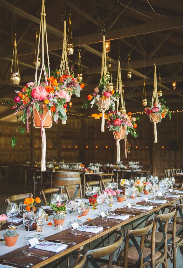 Hanging potted flower arrangements at reception