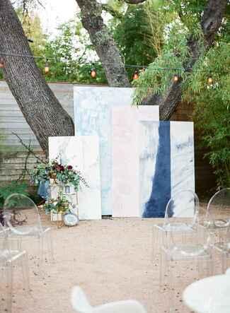 Overlapping canvases creating a unique ceremony altar