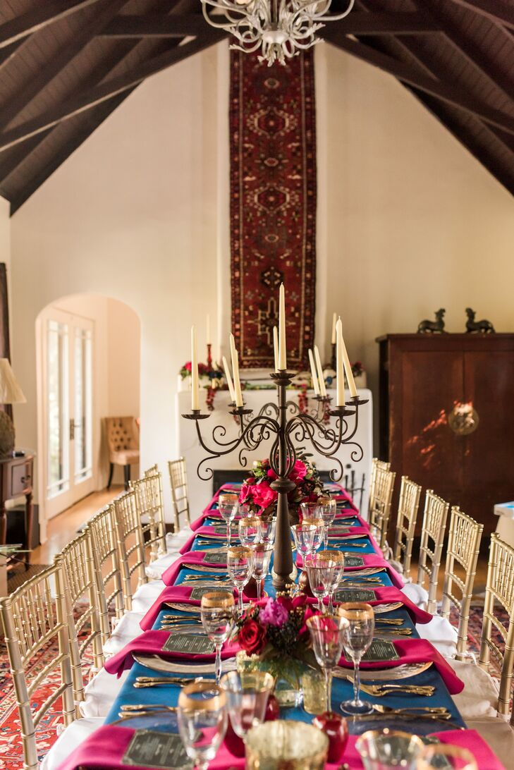 After the intimate ceremony, all 17 guests enjoyed dinner in a banquet room at Platt Place Barn and Inn in Fayetteville, Arkansas, where a meal was served on a long table set with gold candelabras and fuchsia and navy linens.
