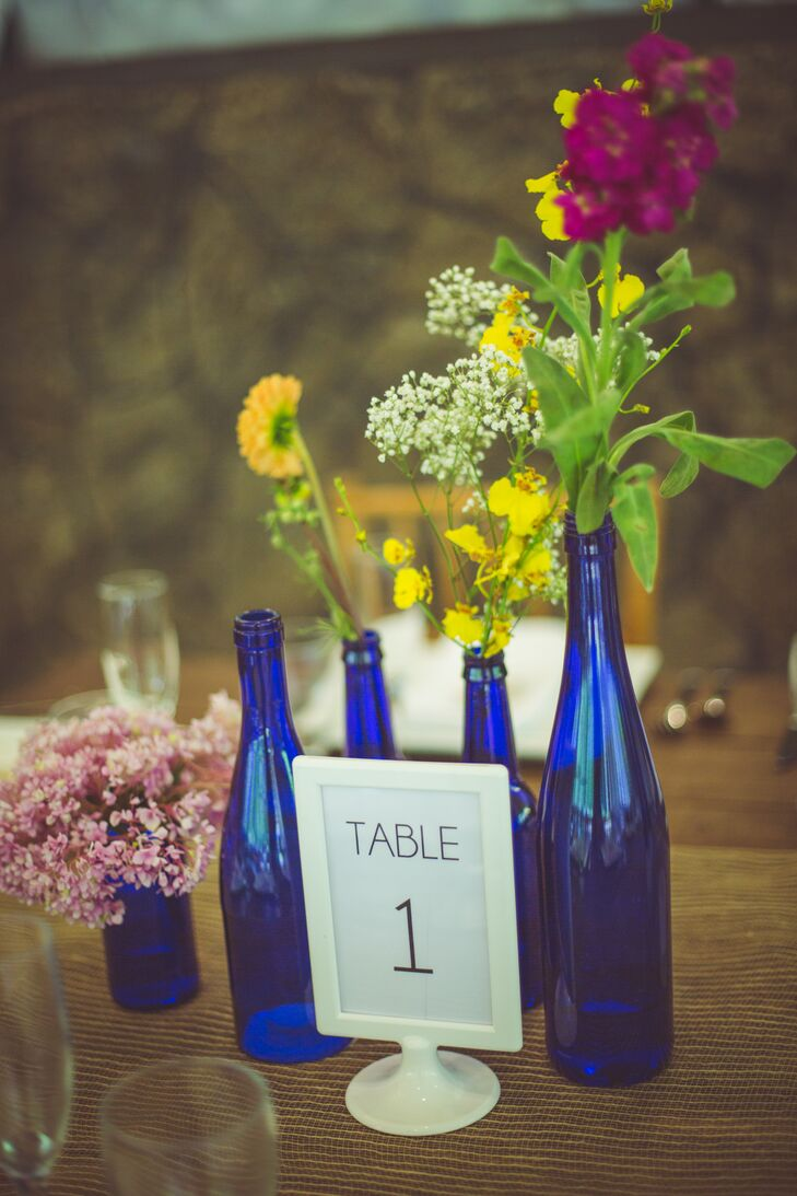 Blue Bottle Centerpiece Table Numbers With Tropical Flowers At Waimea Valley