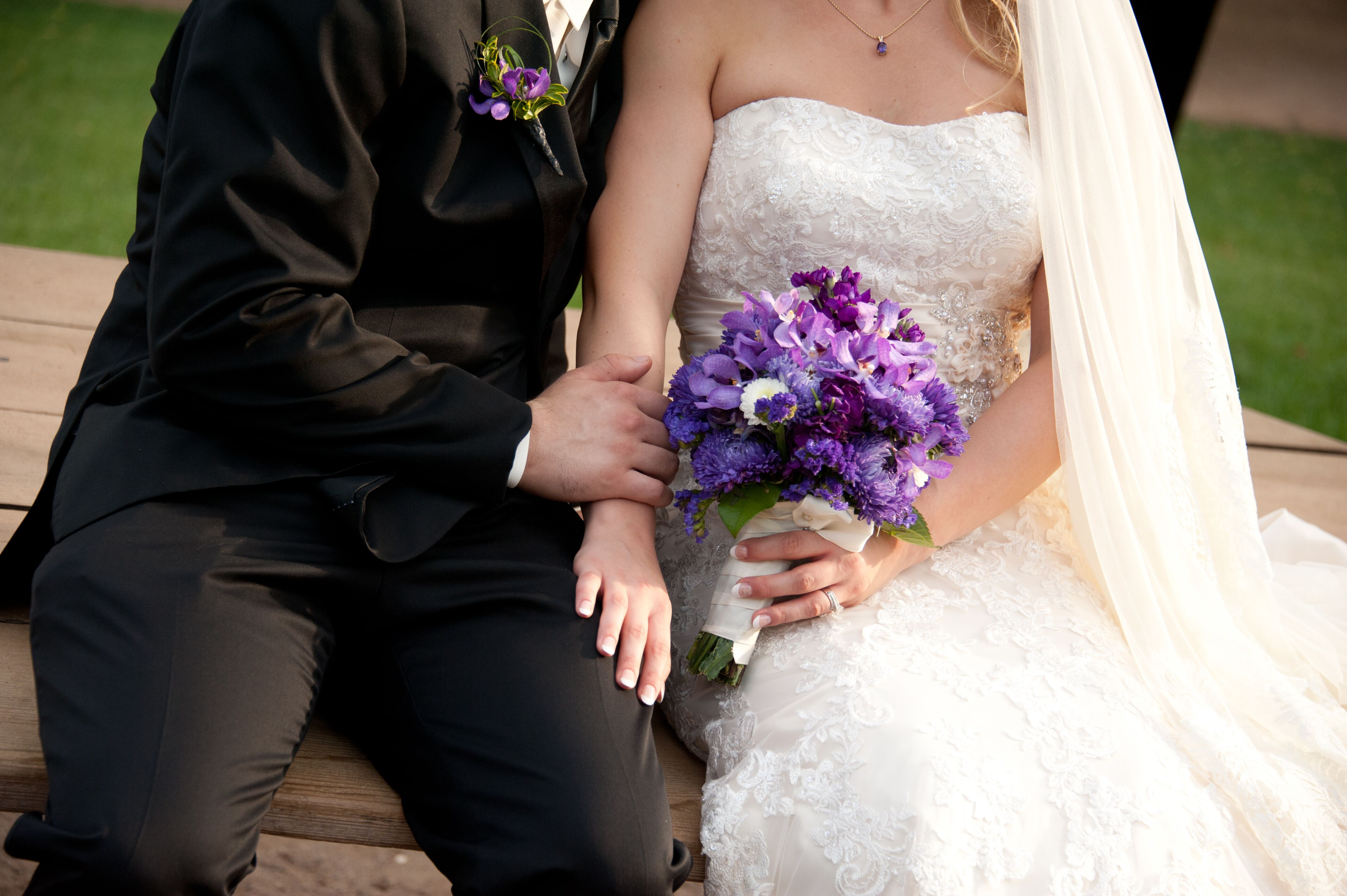 Black Tuxedo And White Lace Wedding Dress With Purple Bouquet