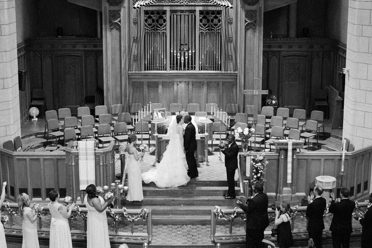 Ali and Willie exchanged vows at Hennepin Avenue United Methodist Church in Minneapolis, Minnesota. Since the traditional church was beautiful all on its own, the couple kept their decor minimal. The aisle was lined with torches from the church, and gold bows, petals and piping added some romance.