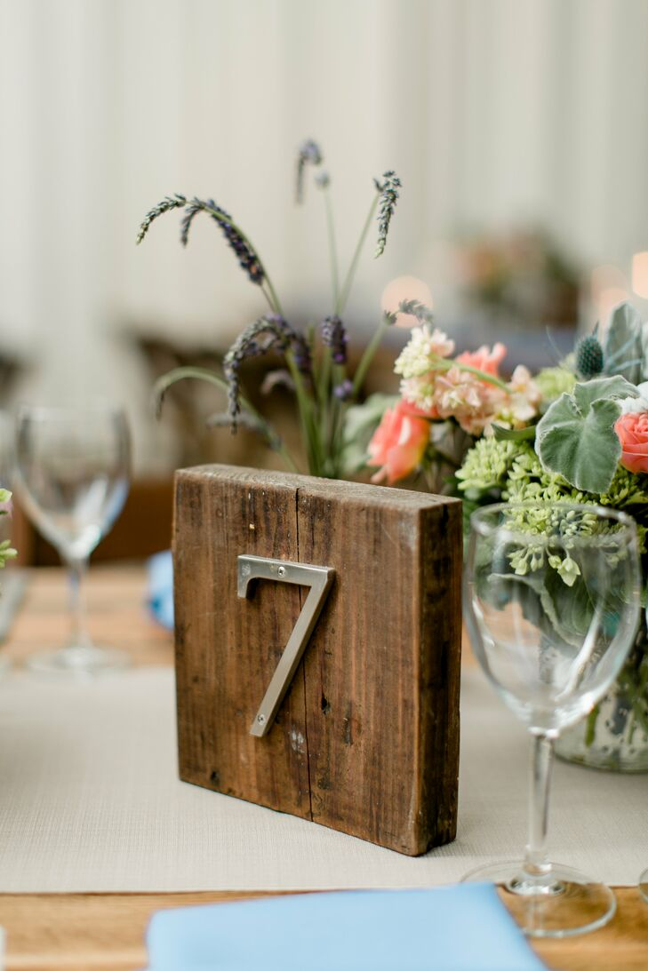 Silver table numbers were attached to small wooden squares, adding to the rustic ambiance.