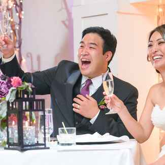 Newly married couple toasting