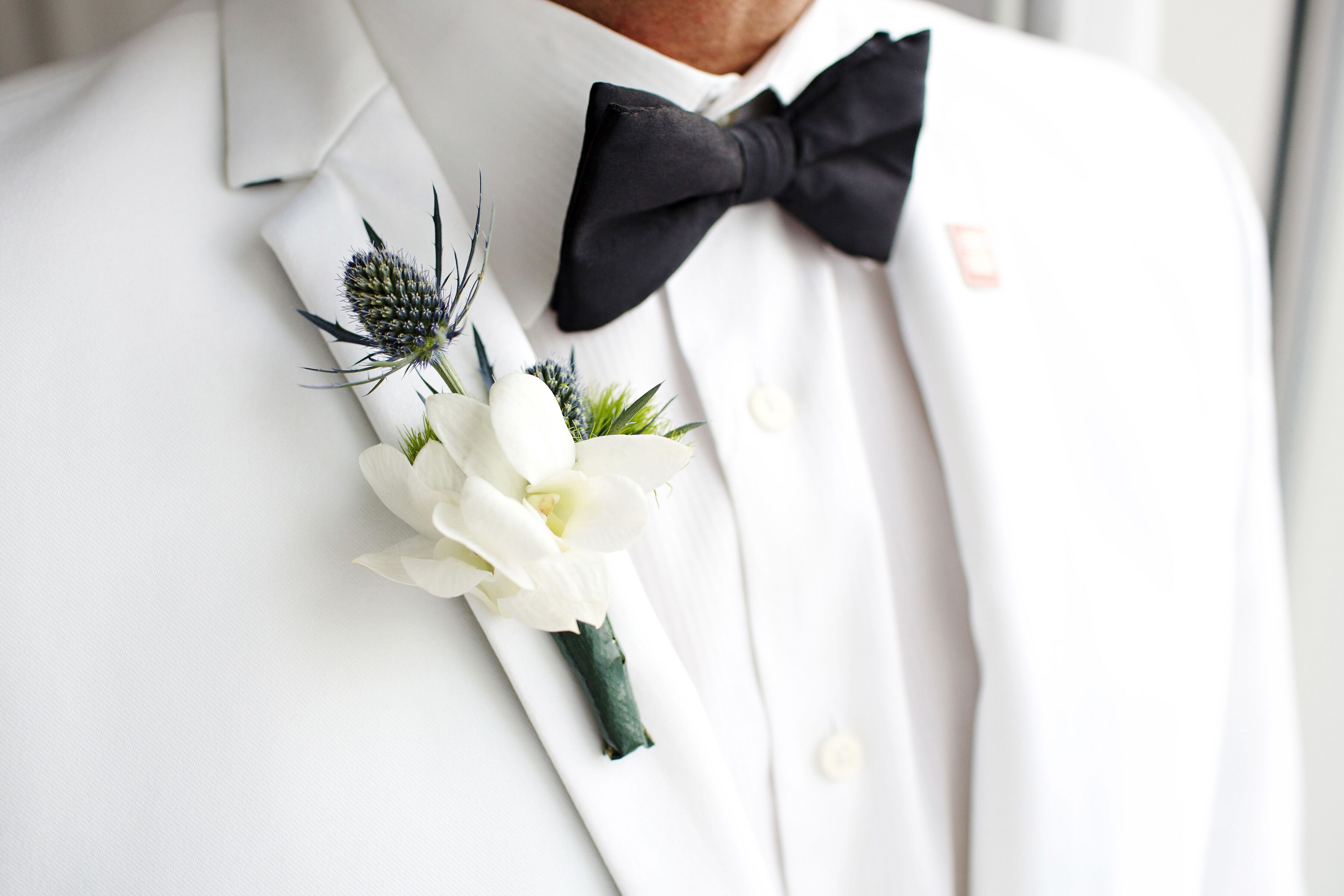 White Orchid Blue Thistle Boutonniere