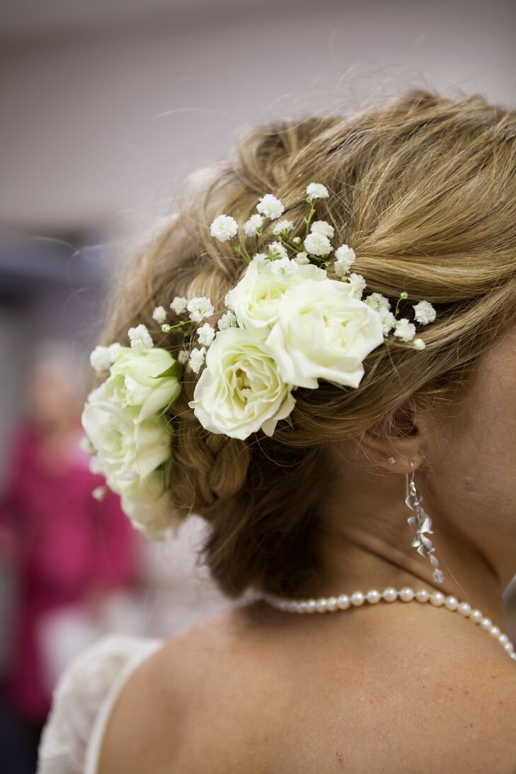 As a finishing touch, Mallory's hairstylist added a cluster of fresh ivory roses to her updo.