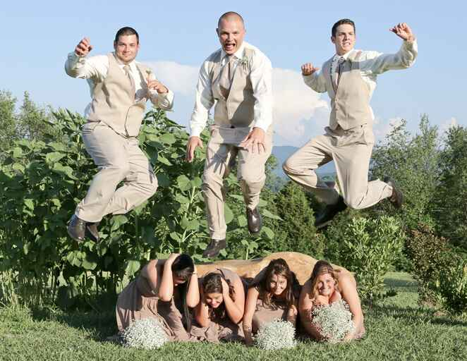 Groomsmen jumping over bridesmaids photo