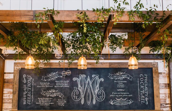 Since the reception took place in a distillery, there was, of course, cocktail hour, featuring beer, wine and a signature drink. Greenery hung above the bar to give the industrial space a natural feel.
