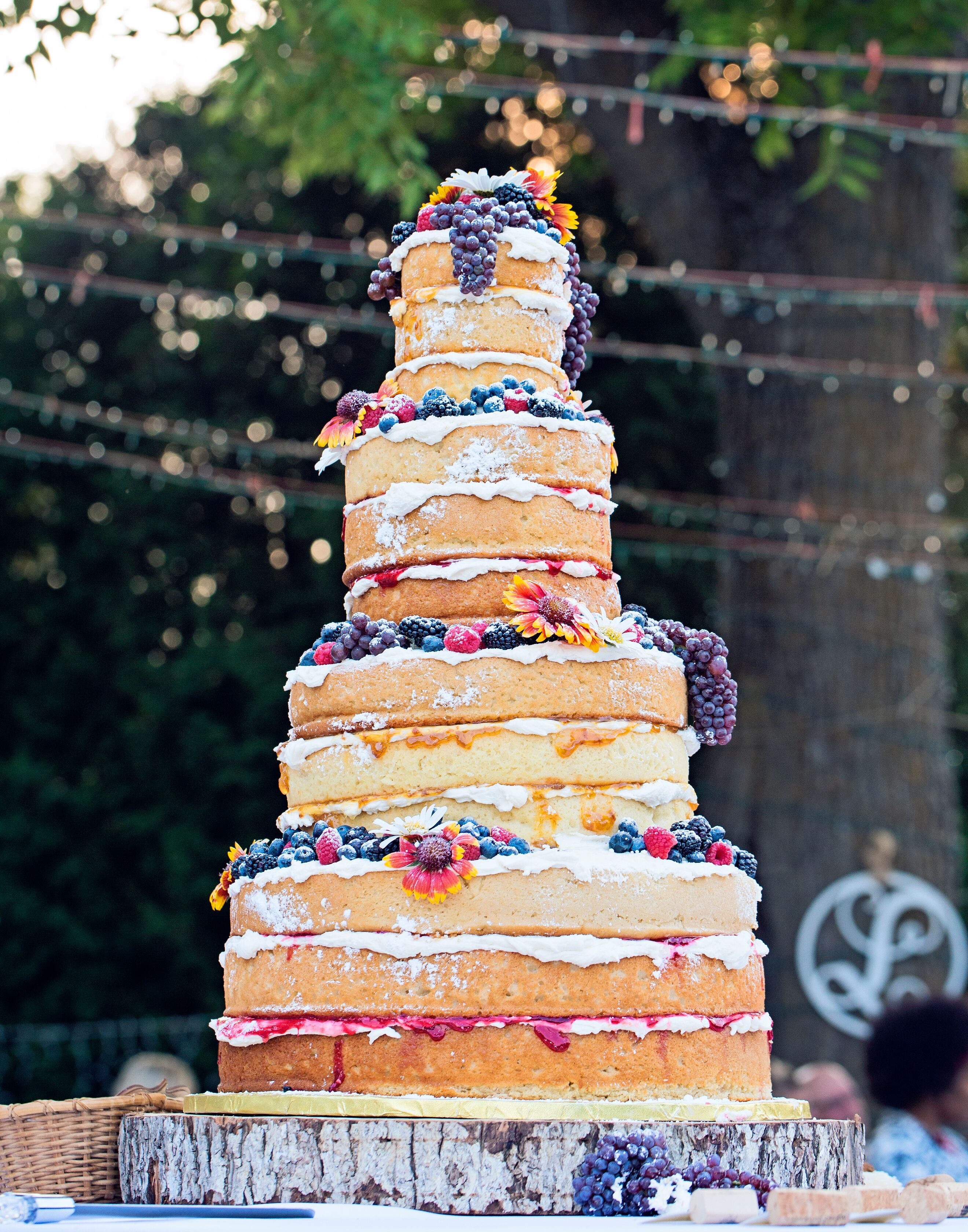 whimsical wedding cake with horse cake topper
