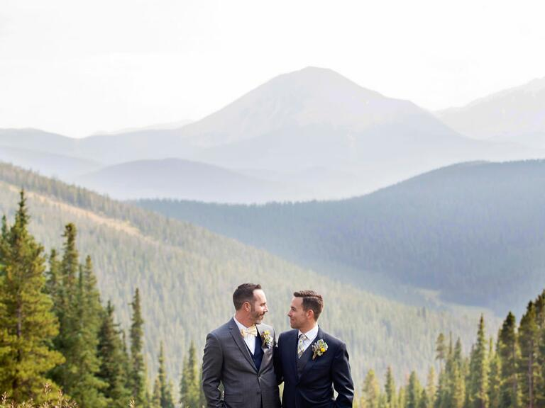 Same sex newlyweds standing in the mountains in Colorado