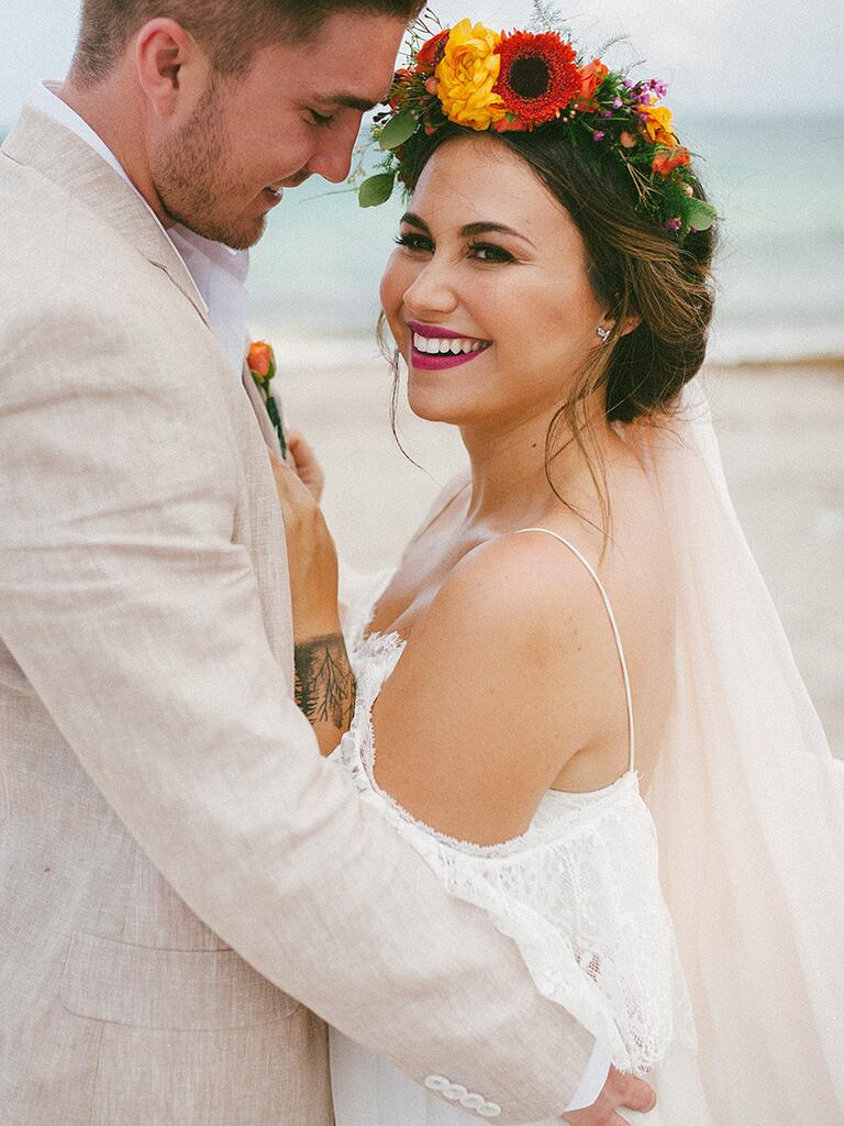 Bright flower crown with an off-white veil