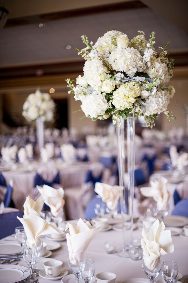 White Roses and Hydrangeas in Tall Cylinder Centerpiece